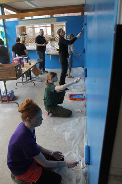 PMG PHOTO: JUSTIN MUCH - A group of 10 Marion Polk Food Share workers visited Woodburn on Tuesday, April 2, to help spruce up Woodburns AWARE Food Bank.