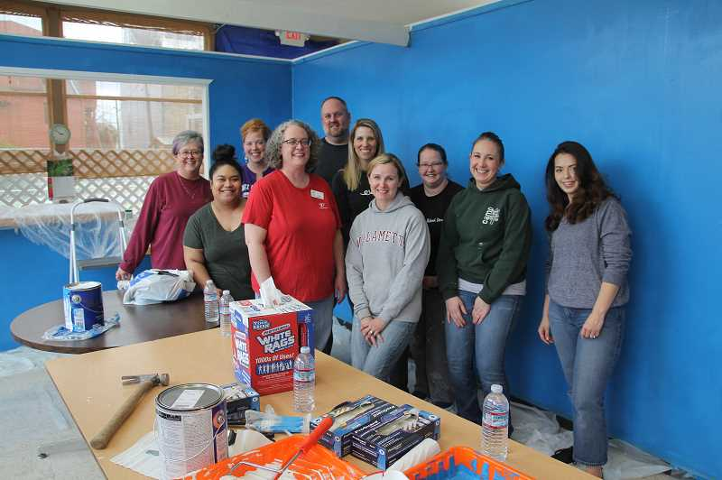 PMG PHOTO: JUSTIN MUCH - A group of Marion Polk Food Share workers ventured to Woodburn on Tuesday, April 2, to help the Woodburn Food Share Coordinator Gabby Pena spruce up the place.  Left to right, Kelly Crawford, Deevon Jano, Sarah Mitchell, Rob Crenshaw, Julie Hambuchen, Robbin Kerner, Corrina Hawkins, Megan Williams, Savannah Langdon, and Gabby Pena.