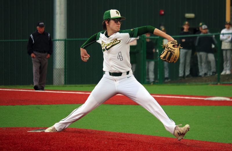 PMG PHOTO: JIM BESEDA - Putnam's Nick Geertsen tossed a three-hitter with seven strikeouts, pacng the Kingsmen to an 8-0 win over St. Helens in Tuesday's Northwest Oregon Conference opener for both teams at Putnam.