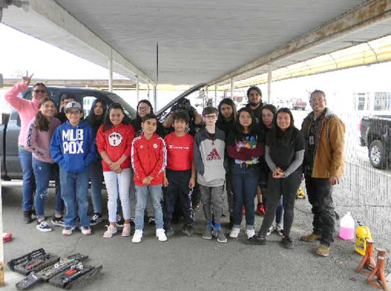 SUBMITTED PHOTO - After completing the auto maintenance course, from left to right, Angelica Flores, Shanti Rodriguez, Steve Gonzalez, Dasen Rodriguez, Michelle Melgarejo, Arianna Flores, Alyssa Castaneda, Osvaldo Castaneda, Alberto Lopez, Amy Melgarejo, Josiah Rice, Katherine Valdez, Itzel Andrade, Noe Melgarejo, Jasmine Velasquez, Evelyn Andrade, and John Courtney gathered for a photo.
