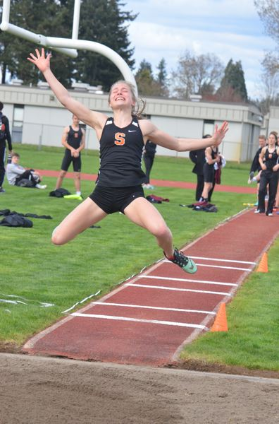 COURTESY PHOTO: JOHN BREWINGTON - Emma Jones of Scappoose High extends in the long jump during a Wednesday home meet against Milwaukie.
