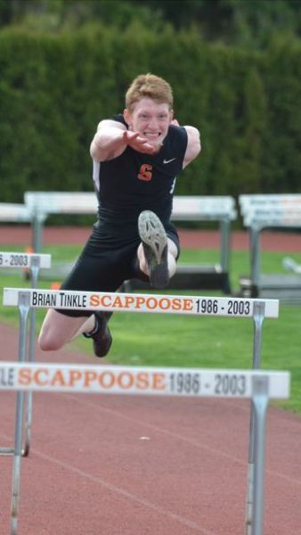 COURTESY PHOTO: JOHN BREWINGTON - Brisyn Maller of Scappoose churns over a hurdle en route to a victory and personal-best time on Wednesday as the Indians defeat visiting Milwaukie.