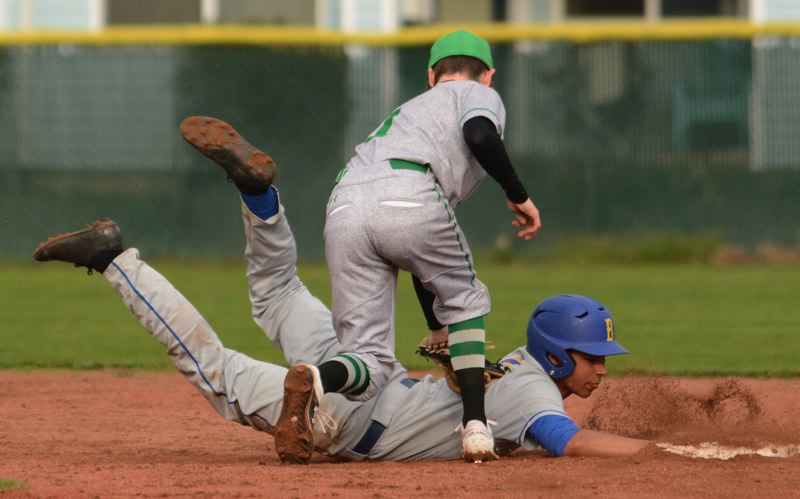 PMG PHOTO: DAVID BALL - Barlows Cole Peterson dives safely back to second base under Reynolds infielder Ethan Jerome during the Bruins 8-1 road win to open the league season Tuesday.