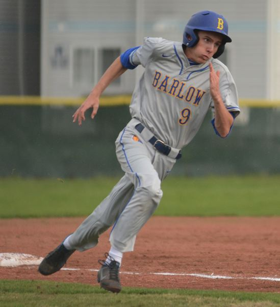 PMG PHOTO: DAVID BALL - Barlows Kanyan Wallace rounds third base on his way to scoring the games first run.