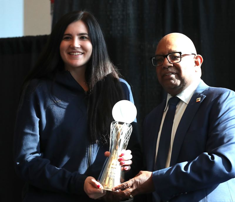 PMG PHOTO: JAIME VALDEZ - Megan Gustafson of Iowa receives the AP Player of the Year Award for women's college basketball on Thursday at the NCAA Final Four in Tampa, Florida.