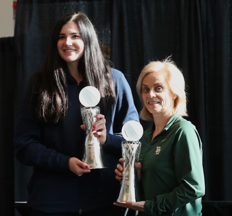 PMG PHOTO: JAIME VALDEZ - Baylor's Kim Mulkey (right) and Iowa Hawkeyes center Megan Gustafson show off their hardware Thursday after being named by the Associate Press as women's college basketball player and coach of the year.