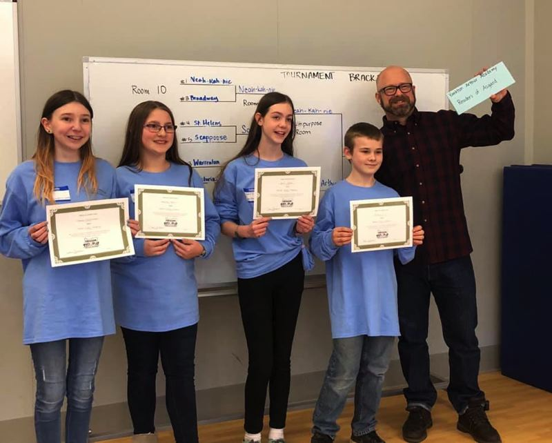 COURTESY PHOTO - A group of sixth-grade students from Yankton Arthur Academy will attend the state-level Oregon Battle of the Books competition on Saturday, April 6. Pictured here, Sammy, Makayla, Sophie, Braden, pose for a photo with their coach, Michael Arthur.
