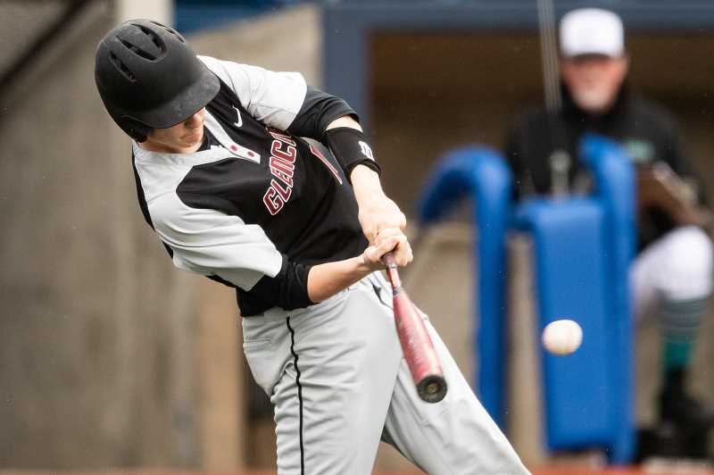 PMG PHOTO: CHRISTOPHER OERTELL - Glencoe's Kyle Wing takes a cut during the Crimson Tide's game against Century Thursday, April 4, at Ron Tonkin Field in Hillsboro.