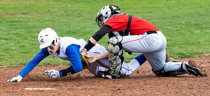 LON AUSTIN/CENTRAL OREGONIAN - Clayton Wilkins is called out in a short play at home plate in the second inning of the Cowboys' 13-3 loss to the Mountain View Cougras in a game that was played Friday night in Prineville.
