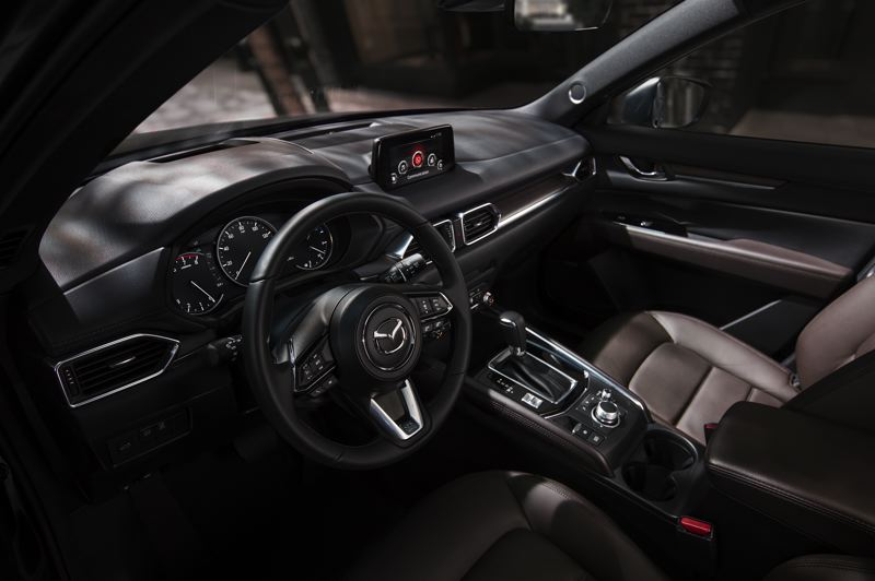 MAZDA NORTH AMERICA - The interior of the 2019 Mazda CX-5 is cleanly designed and available with almost all automotive technologies. The new Signature model, shown here, rivals genuine luxury compact crossover for premium touches.