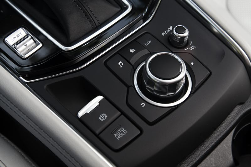 MAZDA NORTH AMERICA - The knob on the center console controls the infortainment system in the 2019 Mazda CX-5, and the available Sport mode delivers noticeable performance increases.