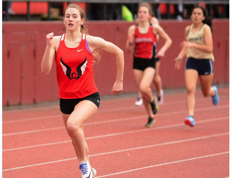 PMG PHOTO: DAVID BALL - Corbetts Sarah McMichael nears the finish line during her second-place finish in the 400-meter dash at Saturday's Sandy Invitational.
