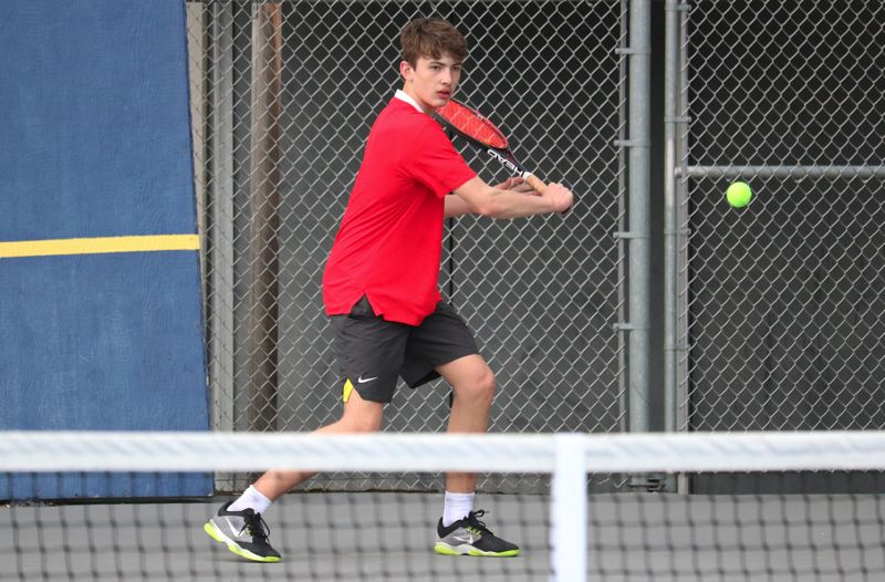 PMG PHOTO: JIM BESEDA - Oregon City's Johannes Schick scored a 6-2, 6-4 victory over Canby's Thijs Peperkamp during Wednesday's Three Rivers League boys tennis match at Canby High School. Oregon City won 6-2.