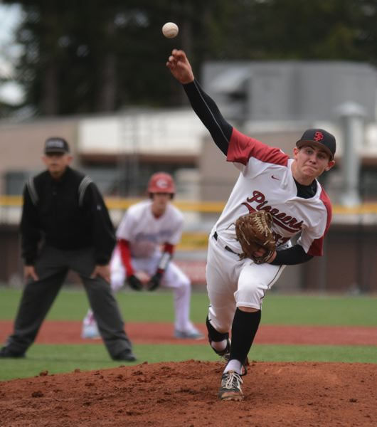 PMG PHOTO: DAVID BALL - Sandy pitcher Quinnton Reilly deals a throw with a runner in motion from second base during the Pioneers 1-0 loss to Centennial last Thursday.