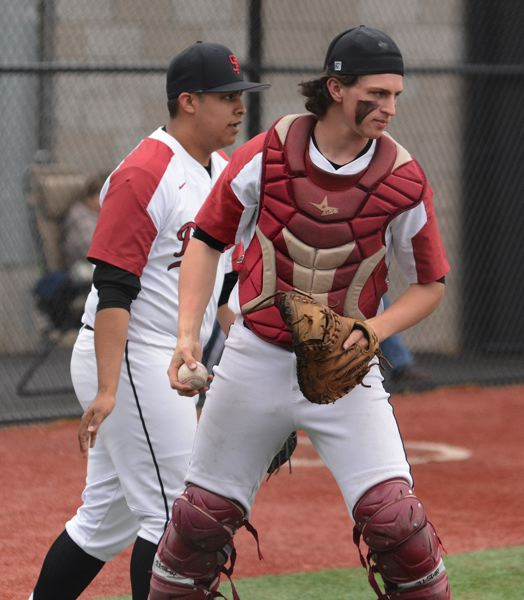 PMG PHOTO: DAVID BALL - Sandy catcher Brendan McAra came up with a foul ball to end the fifth inning.