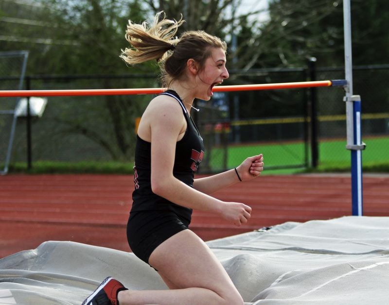 PMG PHOTO: DAN BROOD - Tualatin High School junior Corona Parker celebrates after clearing 5 feet, 1 inch on her final attempt during the high jump competition at last week's meet.