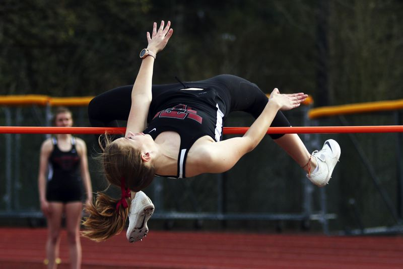 PMG PHOTO: DAN BROOD - Tualatin sophomore Ellie Hammond gets over the bar during the high jump competition during last week's meet at Lake Oswego.