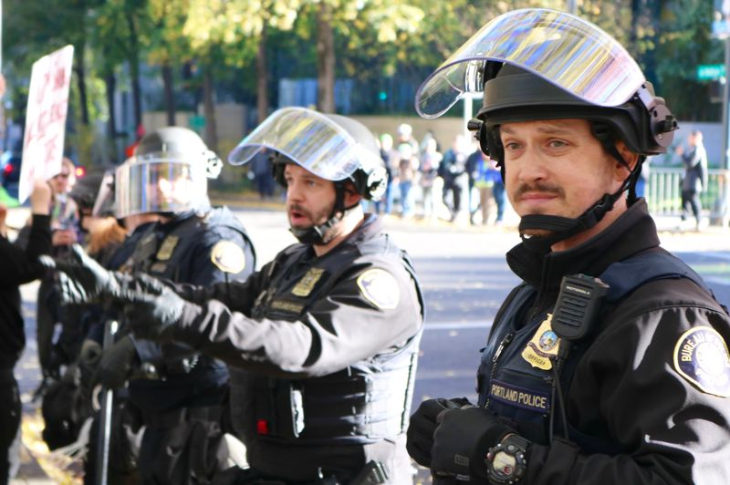 PMG PHOTO: ZANE SPARLING - Officers with the Portland Police Bureau face off with protesters in downtown Portland last year.