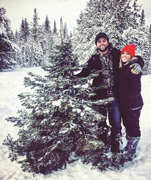 PHOTO COURTESY OF BRANDON FORSETH  - The couple with their Christmas tree.