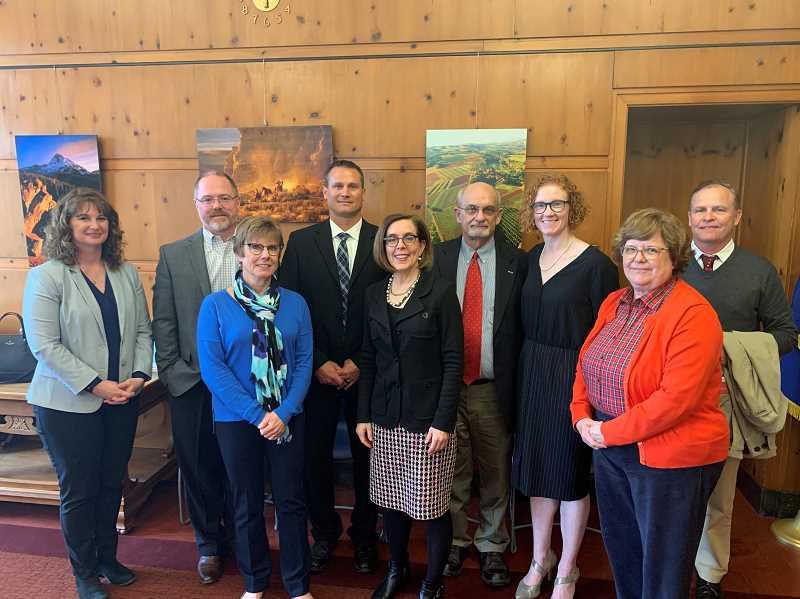 COURTESY PHOTO: CANBY SCHOOL DISTRICT - School board members meet with Governor Kate Brown during their visit to the capitol April 3. Pictured from left to right are: Sara Magenheimer, Rob Sheveland, Diane Downs, Tom Scott, Brown, Mike Zagyva, Angi Dilkes Perry, Andrea Weber and Superintedent Trip Goodall.