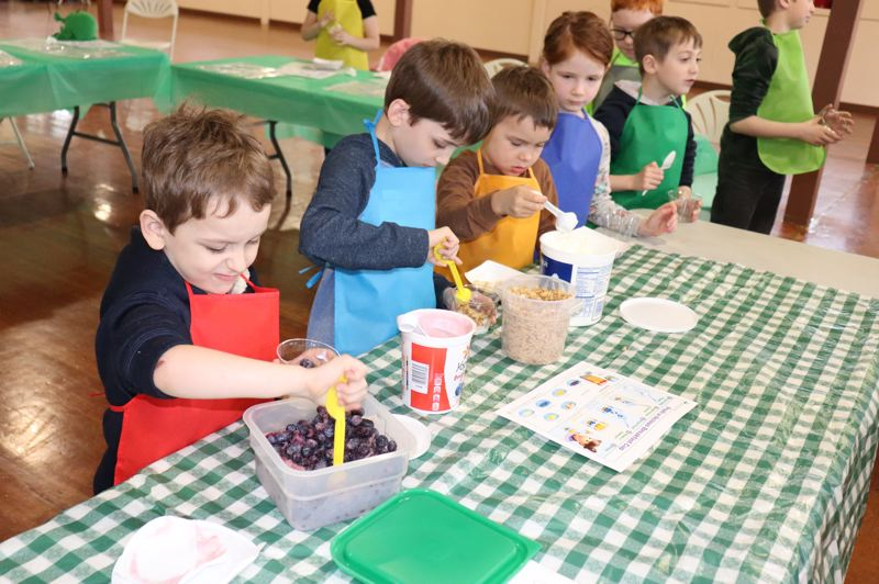 COURTESY PHOTO: KIMBERLY JACOBSEN NELSON - 4-H Cloverbuds make fun, tasty and healthy snacks, including yogurt parfaits at 4-H Spring Break camp.