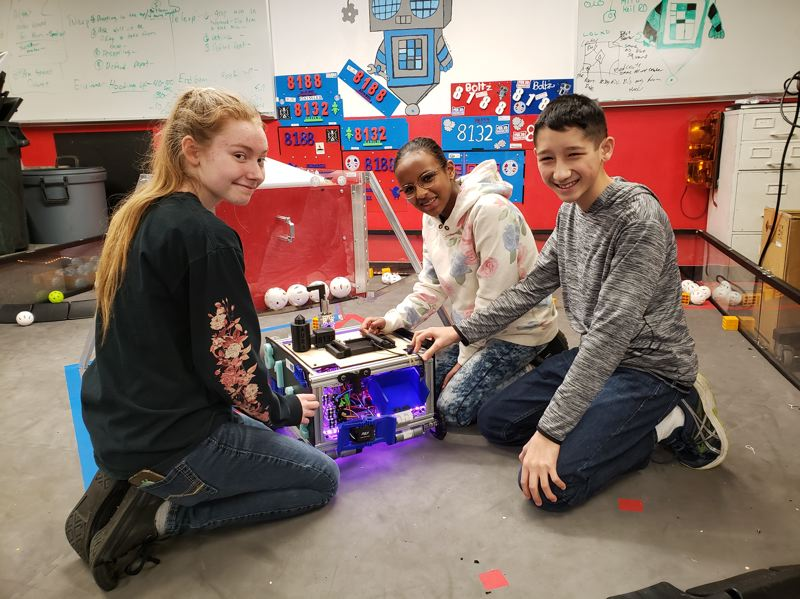 The Kraxberger Gearheads robotics club is one beneficiary of grant money invested by the Gladstone/Oak Lodge Rotary. Pictured are Kraxberger Middle School students Logan Gough, Rose Kurzenhauser and Ben Lau.