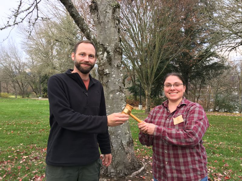 COURTESY PHOTO - Samantha Wolf (right) of Oregon City accepts the presidential gavel to lead the nonprofit board for Oregon Community Trees, succeeding Eric DeBord (left).