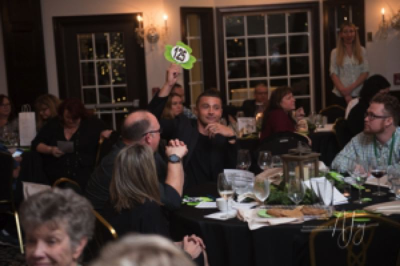 COURTESY PHOTOS - People participate March 16 in the Clackamas Emergency Services Foundation auction at Gray Gables Estate.