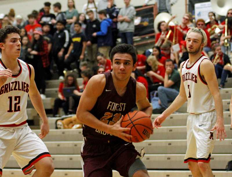 PMG PHOTO: WADE EVANSON - Forest Grove's Guy Littlefield during a game against McMinnville this past season. Littlefield earned honorable mention all-state honors.