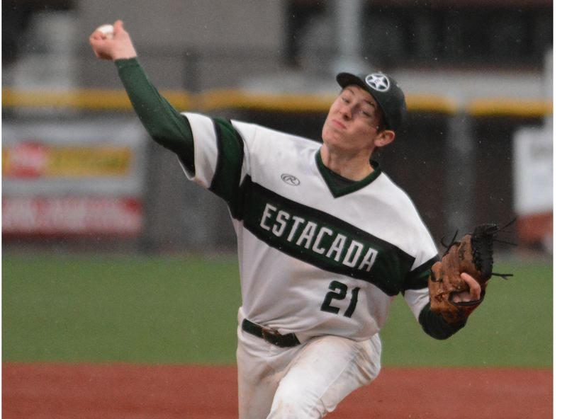 PMG PHOTO: DAVID BALL - Estacada starter Conor McNulty fires a throw to the plate during Mondays 17-4 loss to Gladstone.