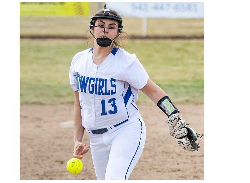 LON AUSTIN/CENTRAL OREGONIAN - Kalyn Martinez delivers a pitch during a game earlier this year. Martinez pitched a no-hitter on Friday as the Cowgirls defeated Mountain View 14-1.