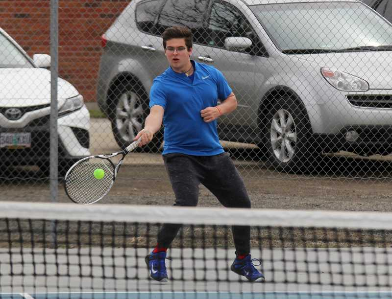 STEELE HAUGEN - Kobey Jorgensen uses his athletism to return a serve. Jorgensen and doubles partner Esteban Gomez claimed gold for the White Buffalos at a home tournament.