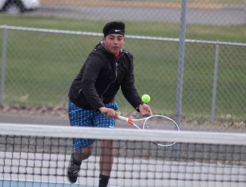 STEELE HAUGEN - Luis Mancera shows off his backhand during a home match. Mancera and doubles partner Sebastian Norato placed fourth in the No. 2 doubles bracket.
