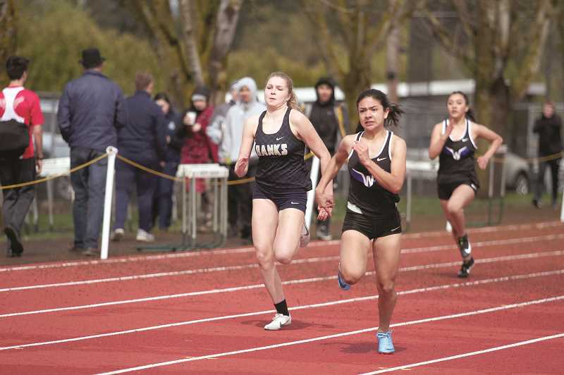 PMG PHOTO: PHIL HAWKINS - Woodburn sophomore Yahaira Rodriguez led the Bulldogs with a pair of top-five finishes in the 100 and 100 hurdles in the track and field teams season opener.