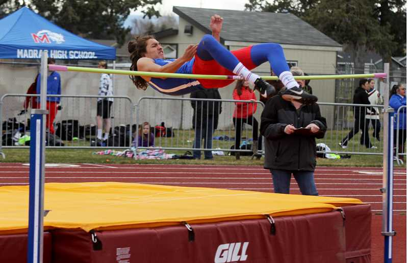 STEELE HAUGEN - Allen Jackson finishes in second in the high jump at Redmond High April 3.