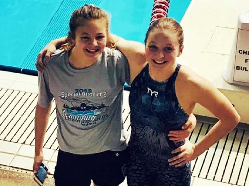 SUBMITTED PHOTO - Elli (left) and Lexi Williams (right) traveled to Federal Way, Washington, competing in an elite Northwest swim meet. Lexi swam personal-best times in four events, including the 100-yard freestyle, placing first. Elli broke a Madras Swim Team record in the 100-yard backstroke.