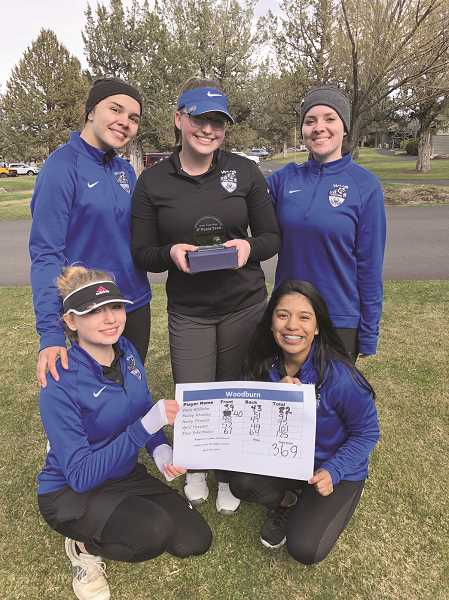 COURTESY PHOTO: NEIL WILHELM - The Woodburn girls golf team matched or improved their scores on Friday at Eagle Crest Golf Course in Redmond.