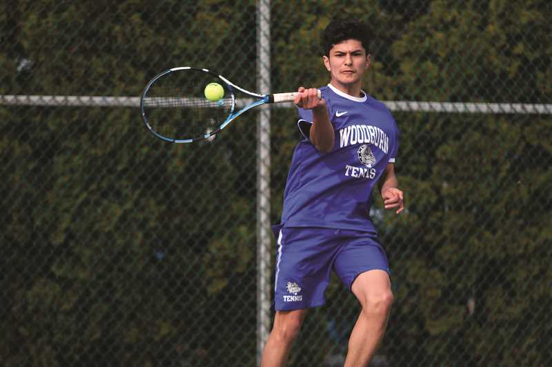 PMG PHOTO: PHIL HAWKINS - Woodburn sophomore Jonathan Swenson is undefeated this season in singles play.