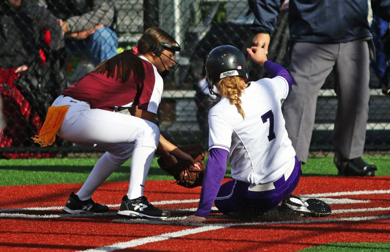 PMG PHOTO: DAN BROOD - Sunset junoir Grace Kimball (right) scores on a passed ball for the first run of Friday's game with Tualatin.