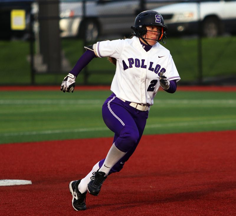 PMG PHOTO: DAN BROOD - Sunset senior Abby Wingo rounds second base and heads to third during the Apollos' game with Tualatin on Friday.