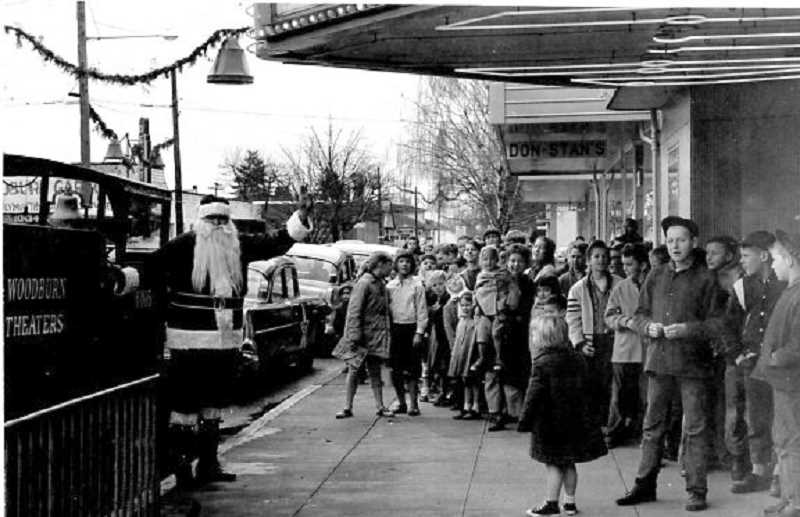 WOODBURN INDEPENDENT FILE PHOTO - Santa at the Pix on First Street. Woodburns former Pix Theater, which originally opened in 1948, is scheduled to be razed as part of the First Street Improvement project.