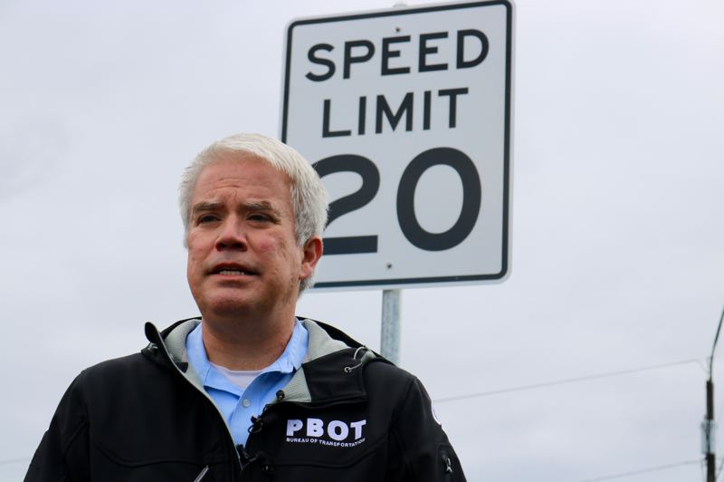 PMG PHOTO: ZANE SPARLING - Portland Bureau of Transportation spokesman Dylan Rivera speaks with reports about the installation of the final 20 MPH speed limit sign on Tuesday, April 9.