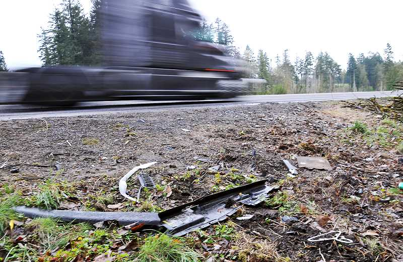 GARY ALLEN - Debris remains on McKay Road after a two-vehicle collision two weeks ago took the lives of three individuals.