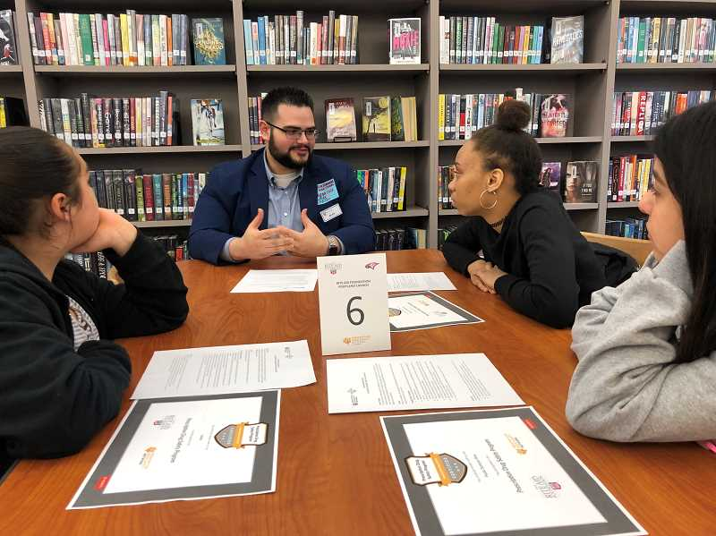 COURTESY PHOTO - Centennial High School students talk to Rite Aid leaders about the program.