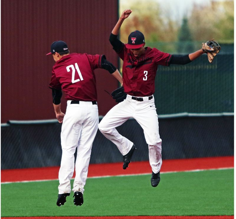 PMG PHOTO: DAN BROOD - Tualatin High School junior Campbell Clarke (left) and senior Lucas Diggins celebrate following the Wolves' 5-3 win over Lakeridge on Monday.