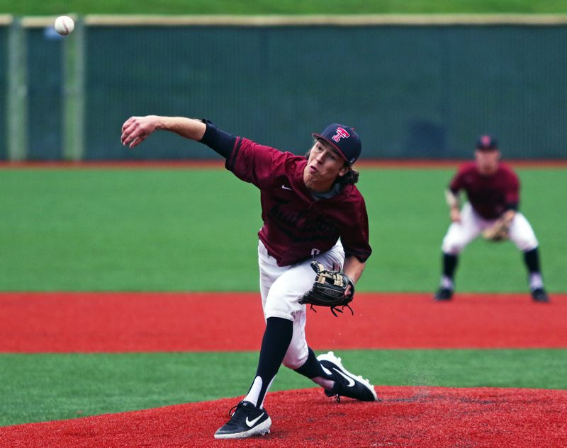 PMG PHOTO: DAN BROOD - Tualatin High School senior Cameron Atkinson fires a pitch to the plate during the Wolves' 5-3 win over Lakeridge on Monday.