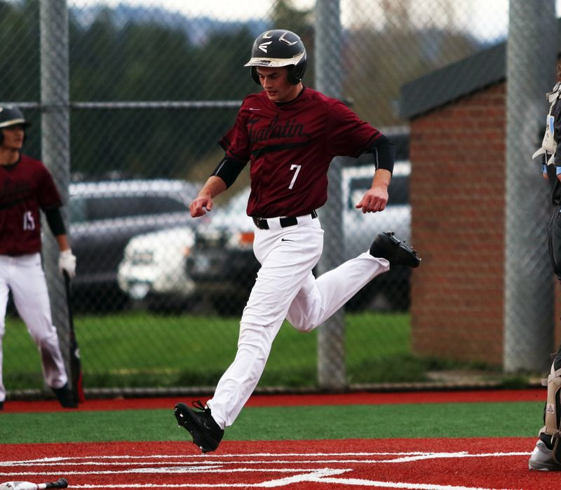 PMG PHOTO: DAN BROOD - Tualatin High School junior Blake Jackson comes in to score a run during the Wolves' 5-3 win over Lakeridge on Monday.