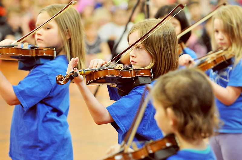 GARY ALLEN - Edwards Elementary School students show off their prowess on the violin in conjunction with the BRAVO Youth Orchestra from Portland on Friday in Newberg.