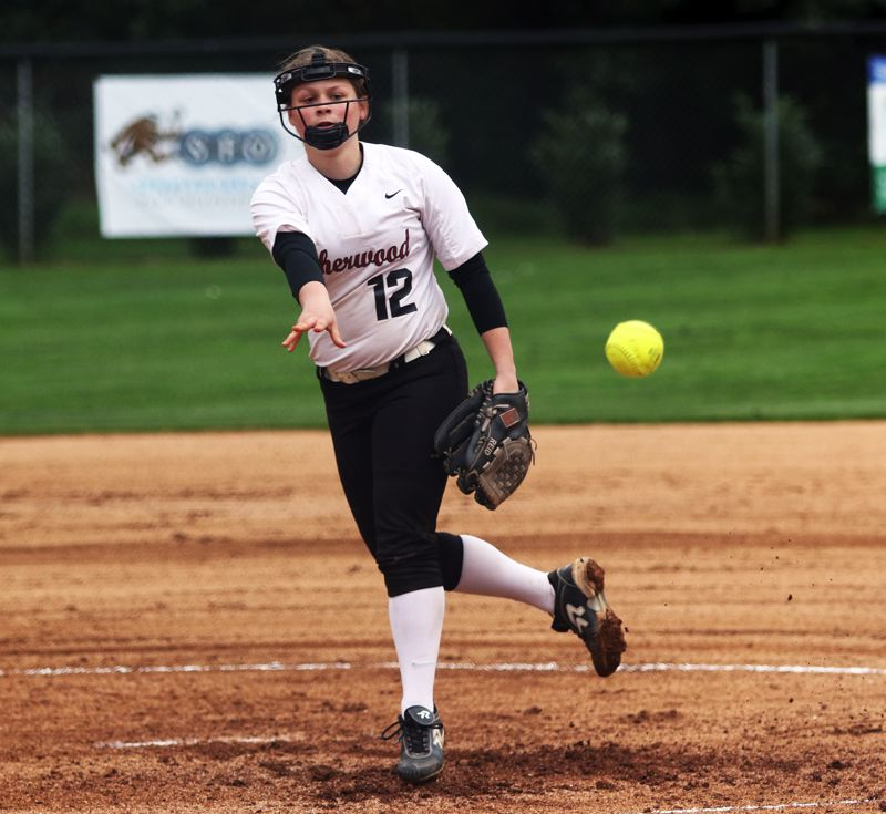 PMG PHOTO: DAN BROOD - Sherwood High School senior Josie Reid fires in a pitch in the first inning of the Lady Bowmen's 11-0 win over Gresham on Tuesday.