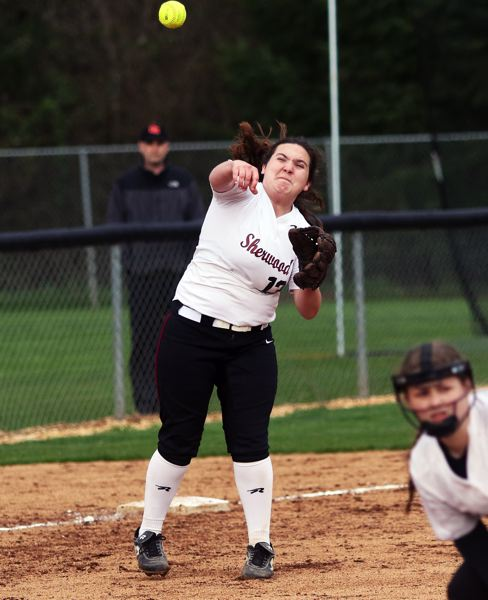 PMG PHOTO: DAN BROOD - Sherwood senior third baseman J.J. Pringle makes a throw to first during the Lady Bowmen's win over Gresham.